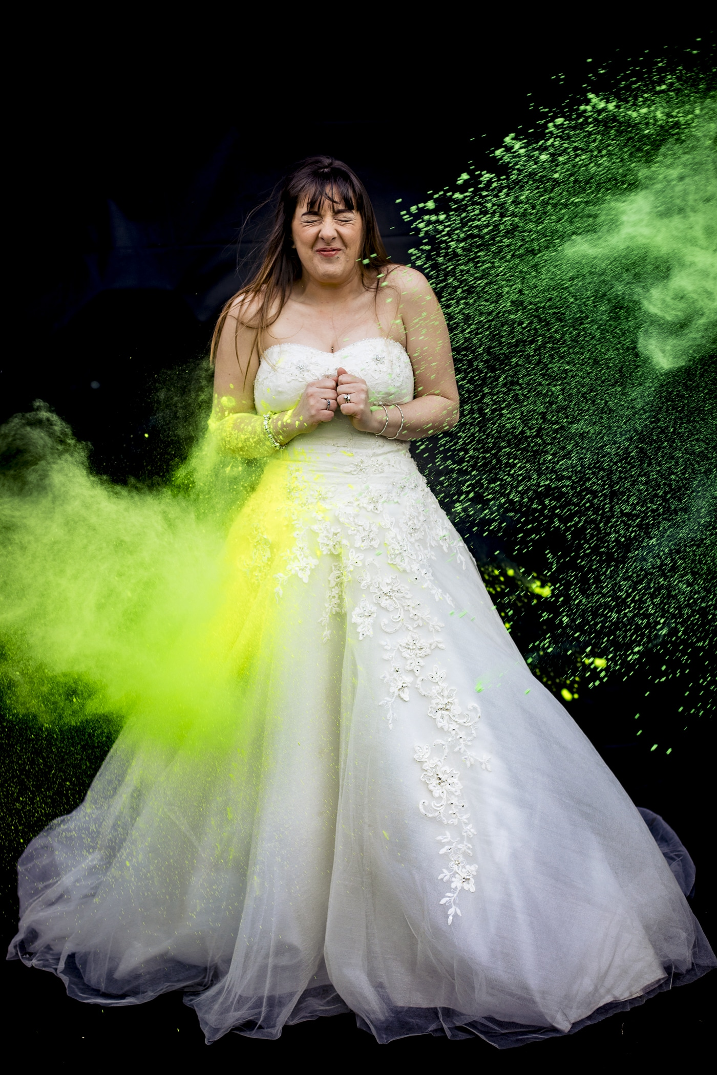 bride Trash the dress with black background and vivid paint from paintglow