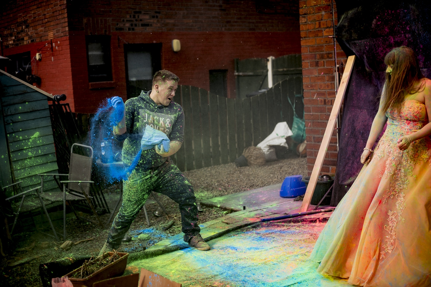 behind the scenes as Close up of bride after she trashed her dress with paint from Paintglow