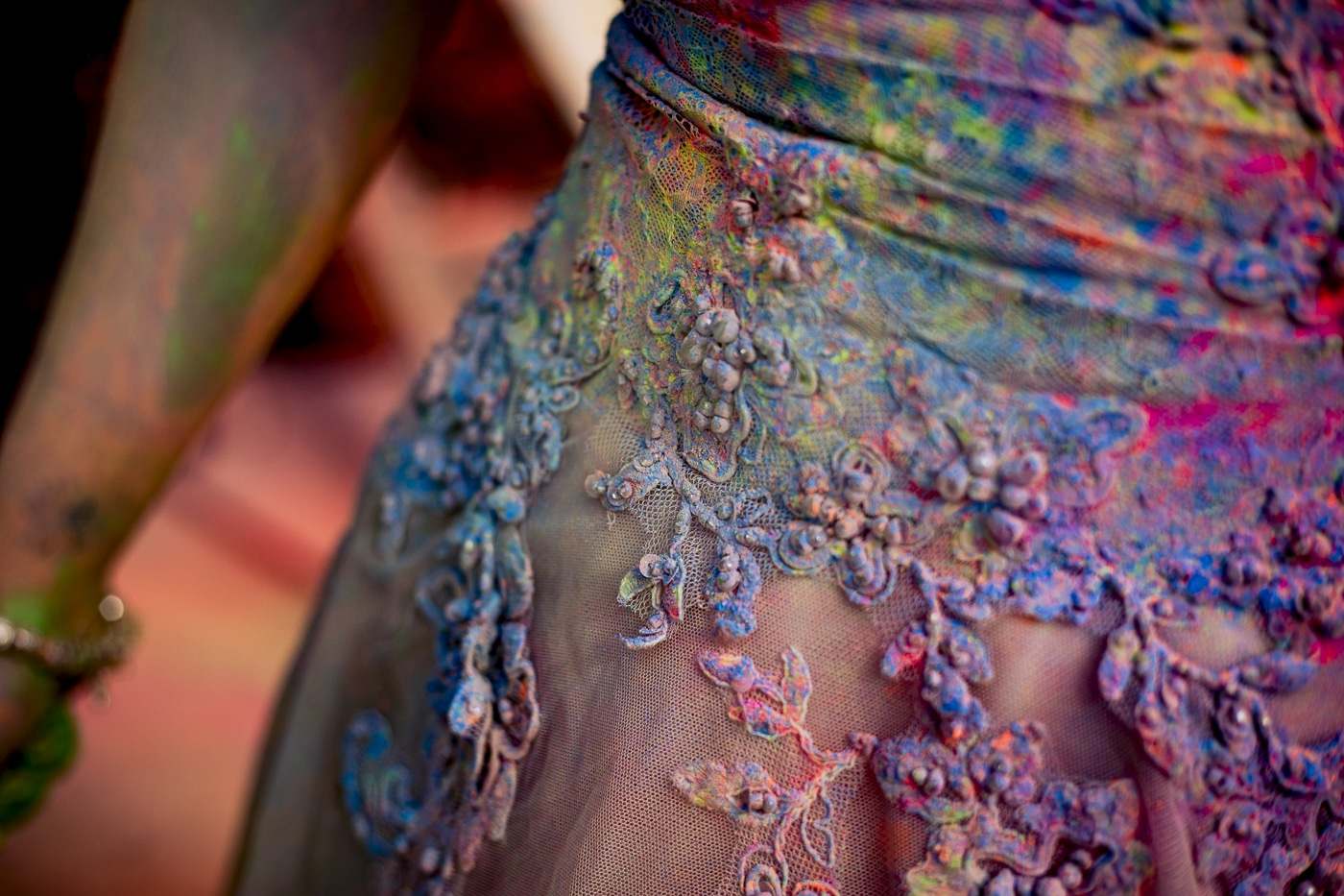 Close up of bride after she trashed her dress with paint from Paintglow and smiles