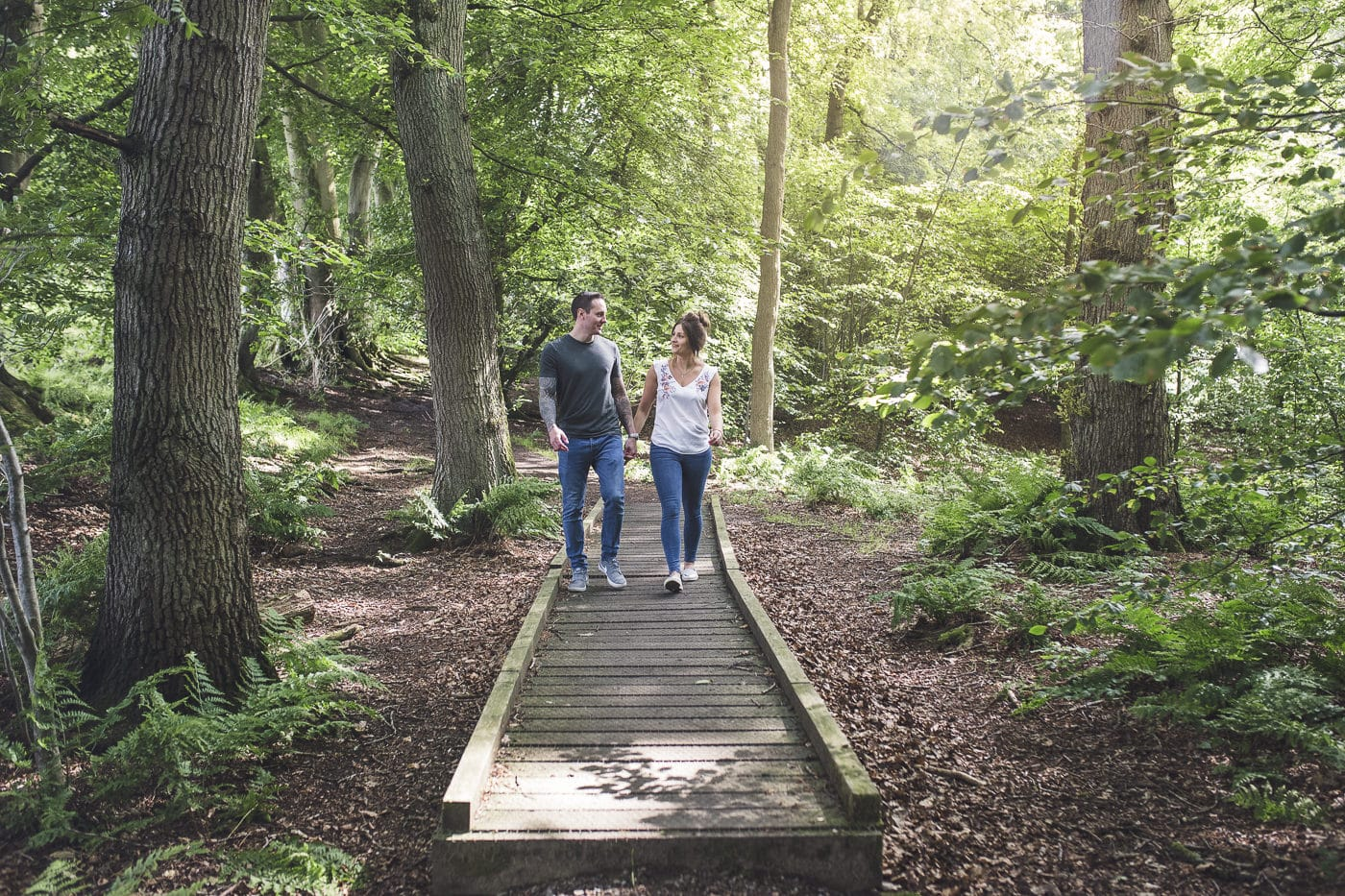 Couple walking through the woods on a Cumbria Couple Portrait Session