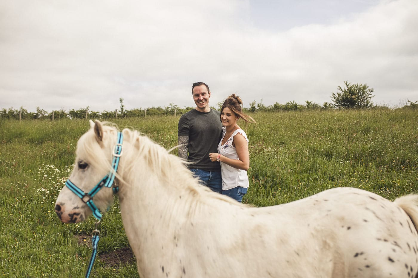 couple photoshoot photo photobombed by a horse
