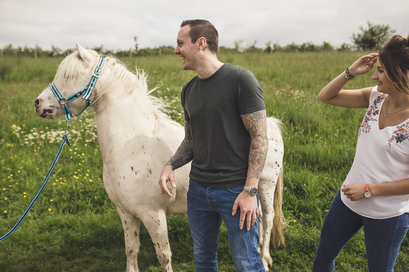 couple Portrait session photobombed by a horse in cumbria