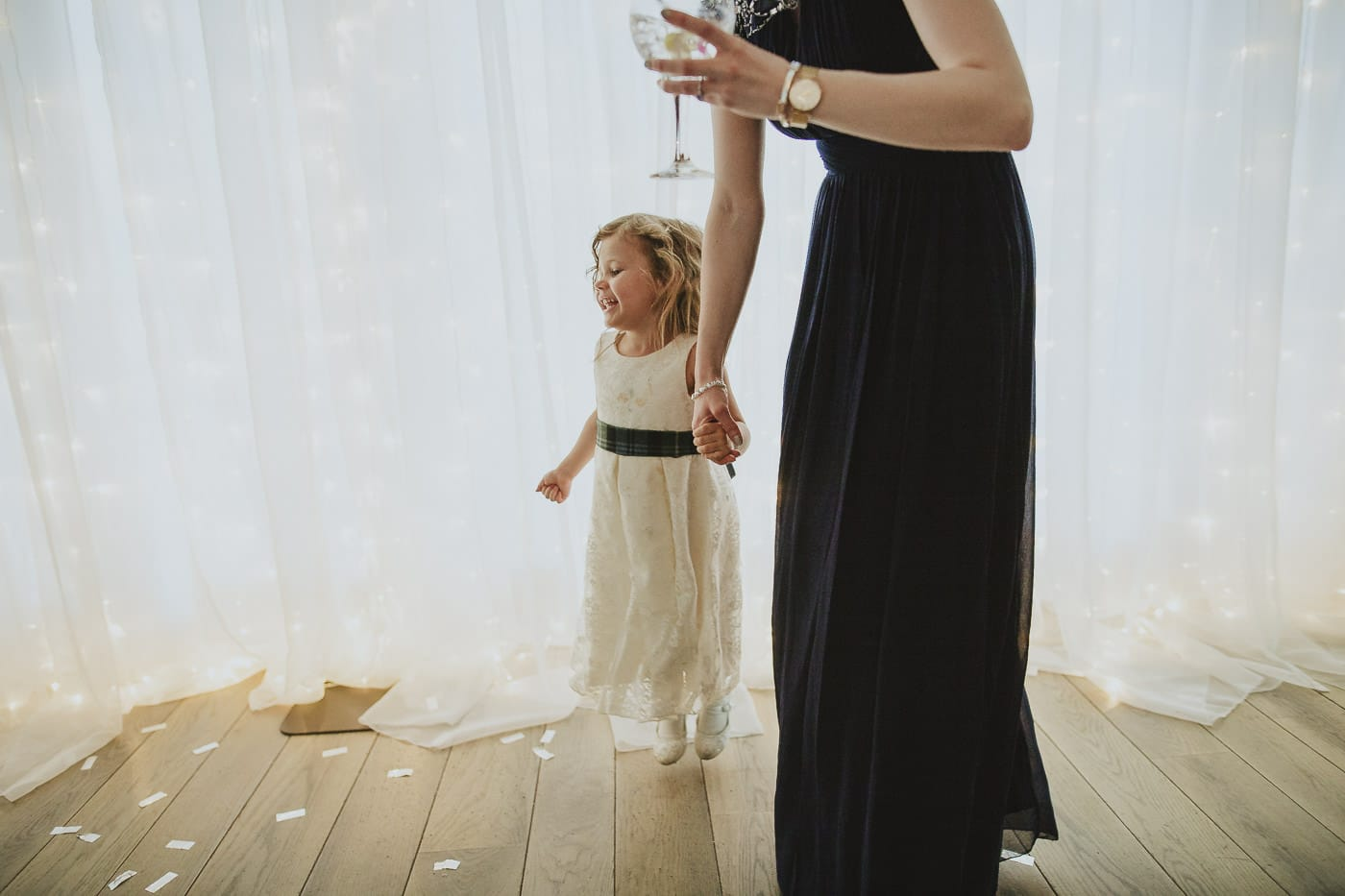 Little bridesmaid dancing after first dance at the inn on the lake wedding reception