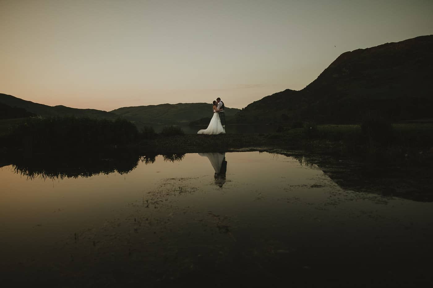 Inn on the lake couple photograph of bride and groom at Ullswater lake shore