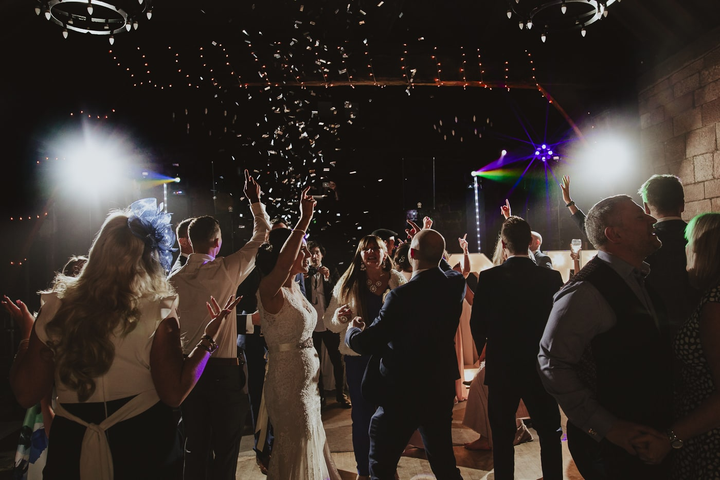 Bride and groom with confetti canon on the dance floor