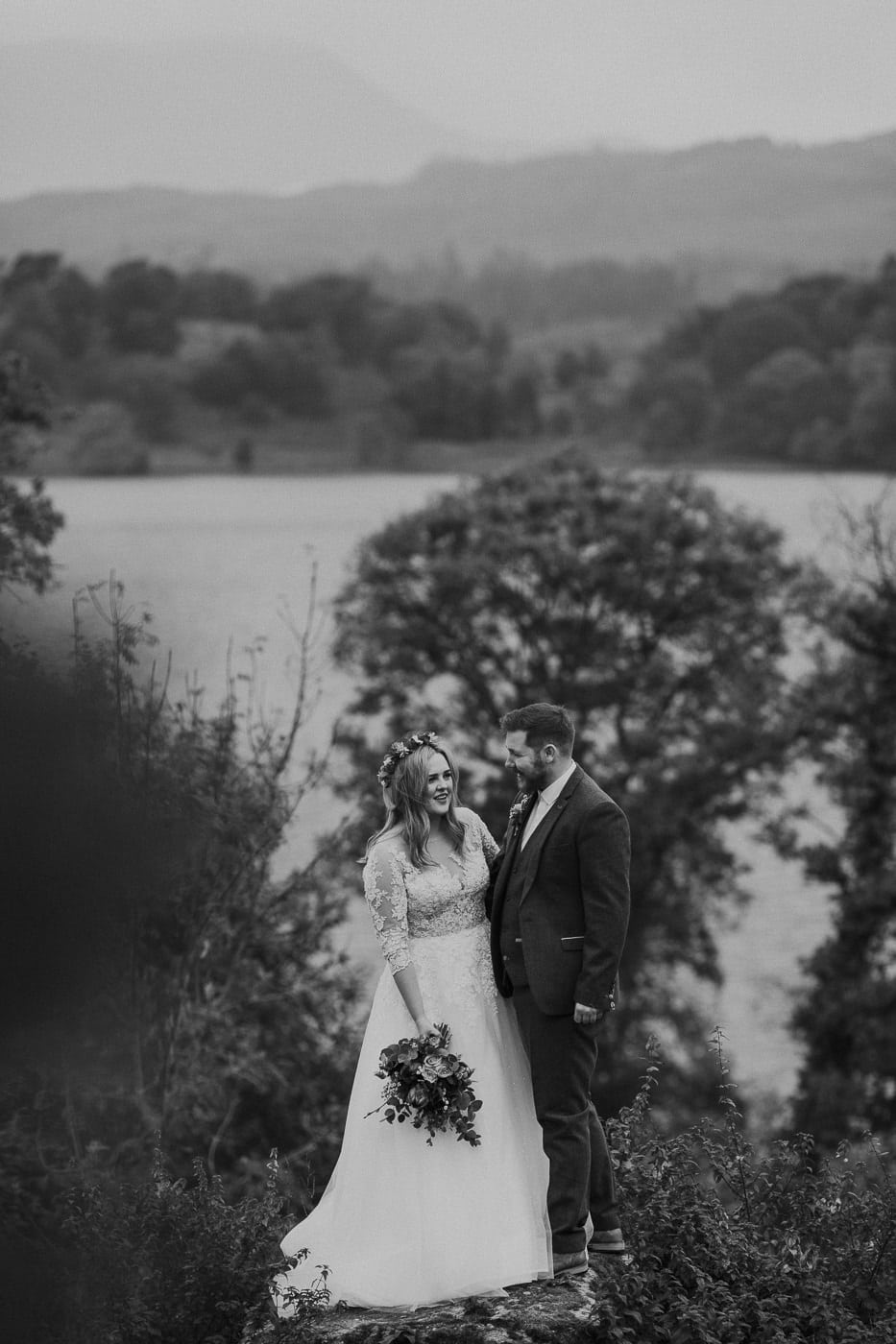 Cumbria Elopement Photogrpah at the Cragwood Country House Hotel Just Us Package Bride and Groom Stood on Rock at Winderemere