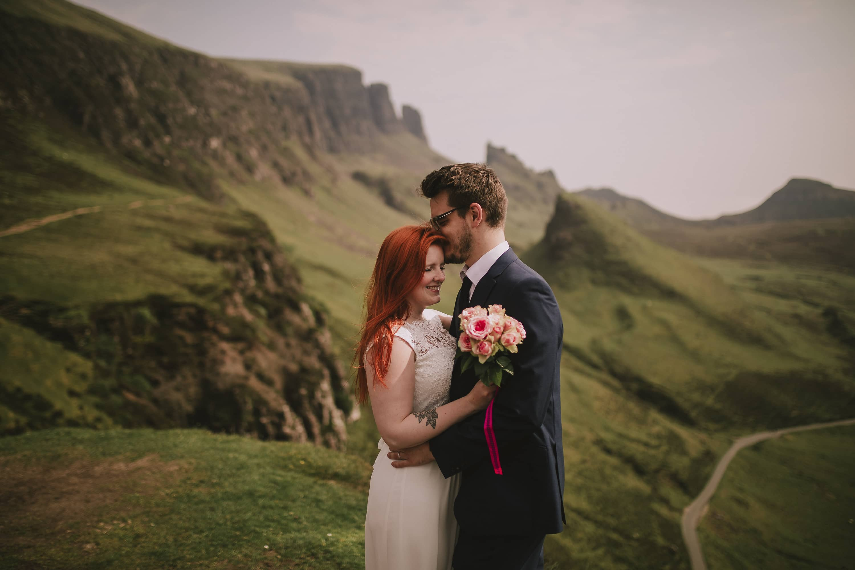Bride and Groom on top of a mountain in Skye Scotland