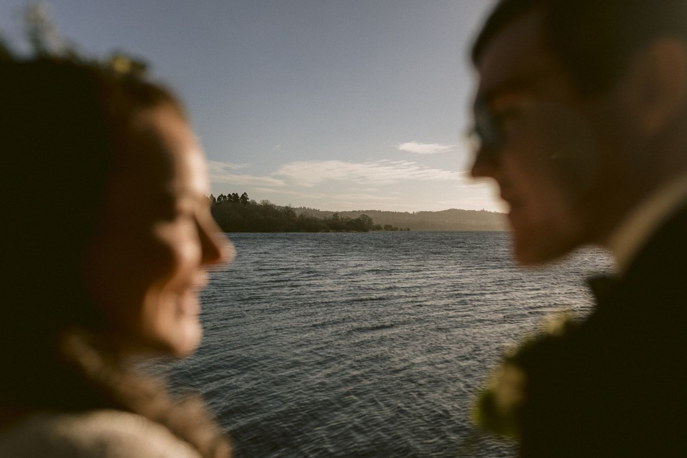 Eloping Couple stood at edge of a lake on their elopement adventure