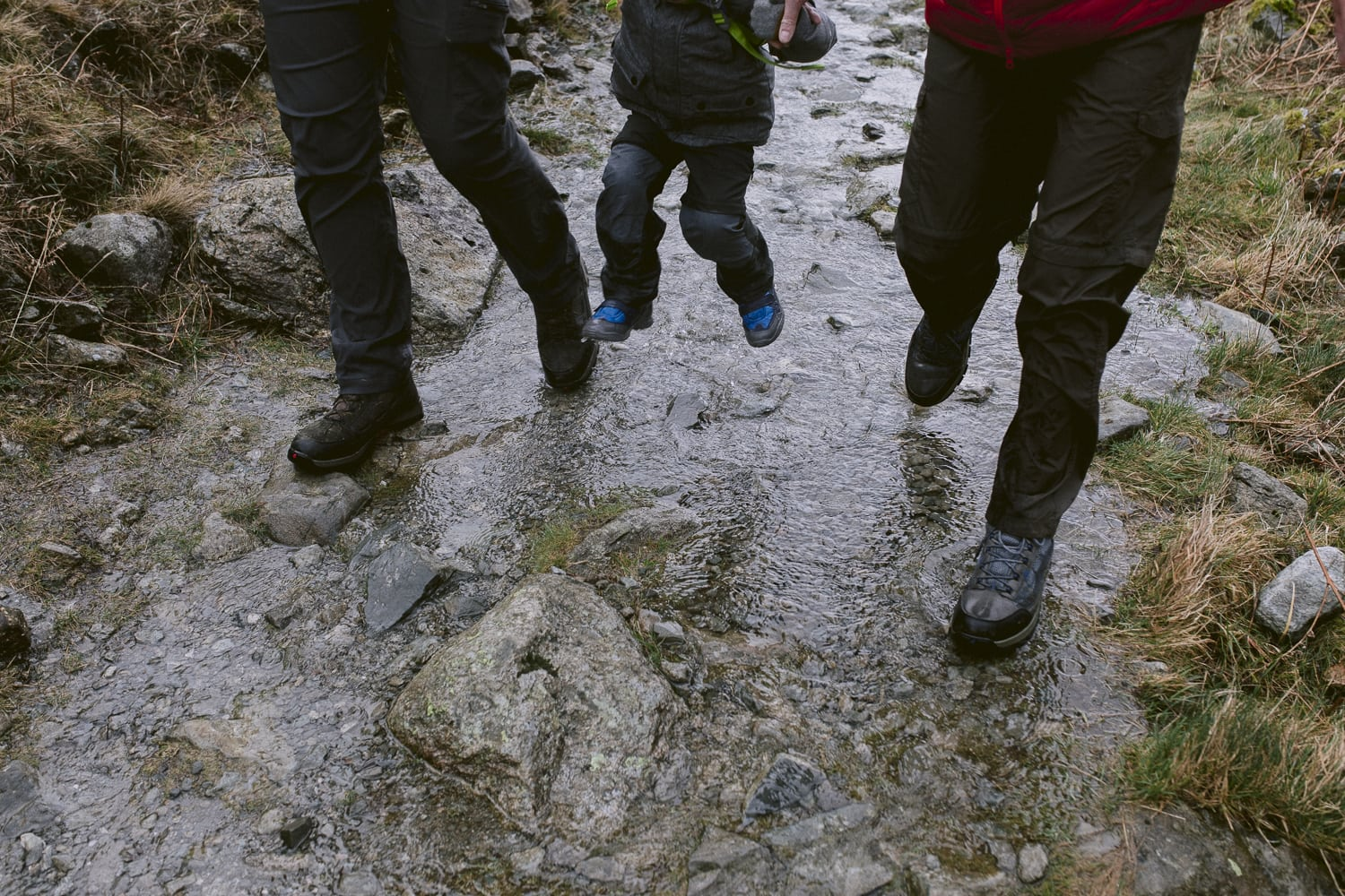Jumping puddles with dad and daddy in the lake district