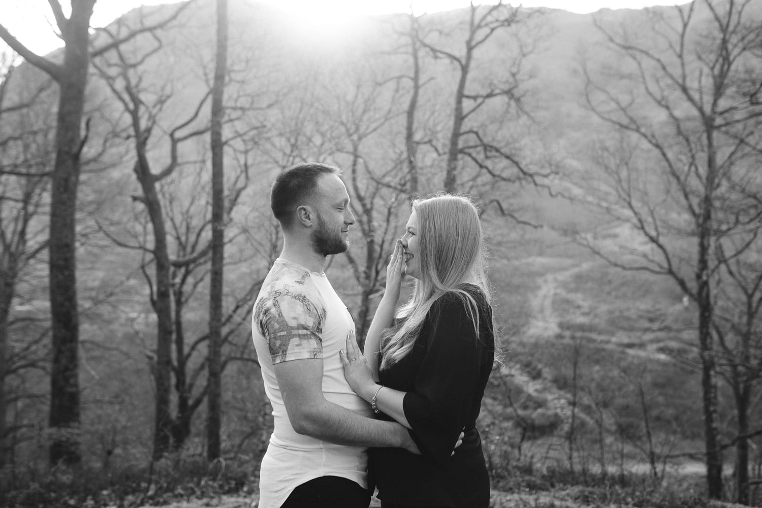 A couple stood on Grasmere in a couple portrait session