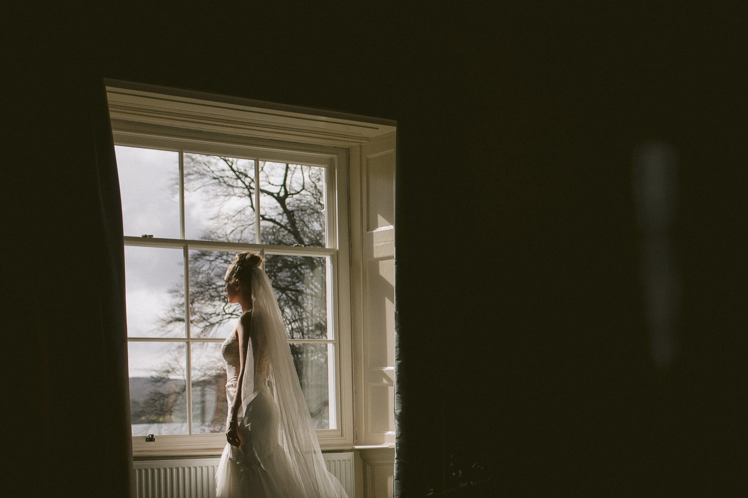 Bride looking out Storrs Hall Bedroom Window