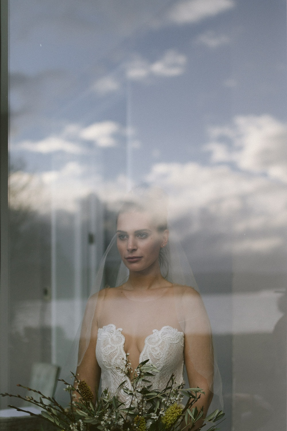 Storrs Hall with bride in window