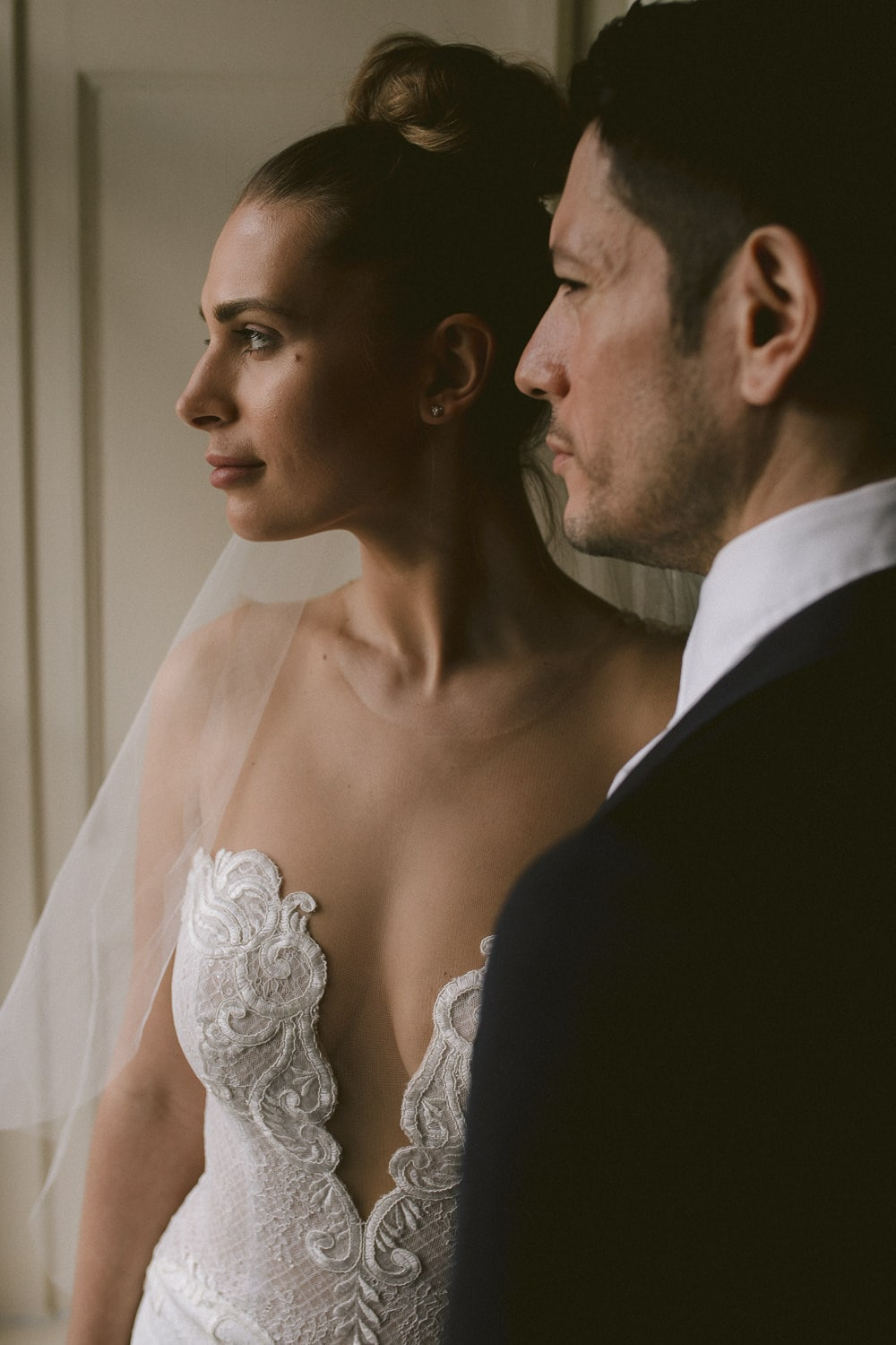 Bride and groom in Storrs Hall window light
