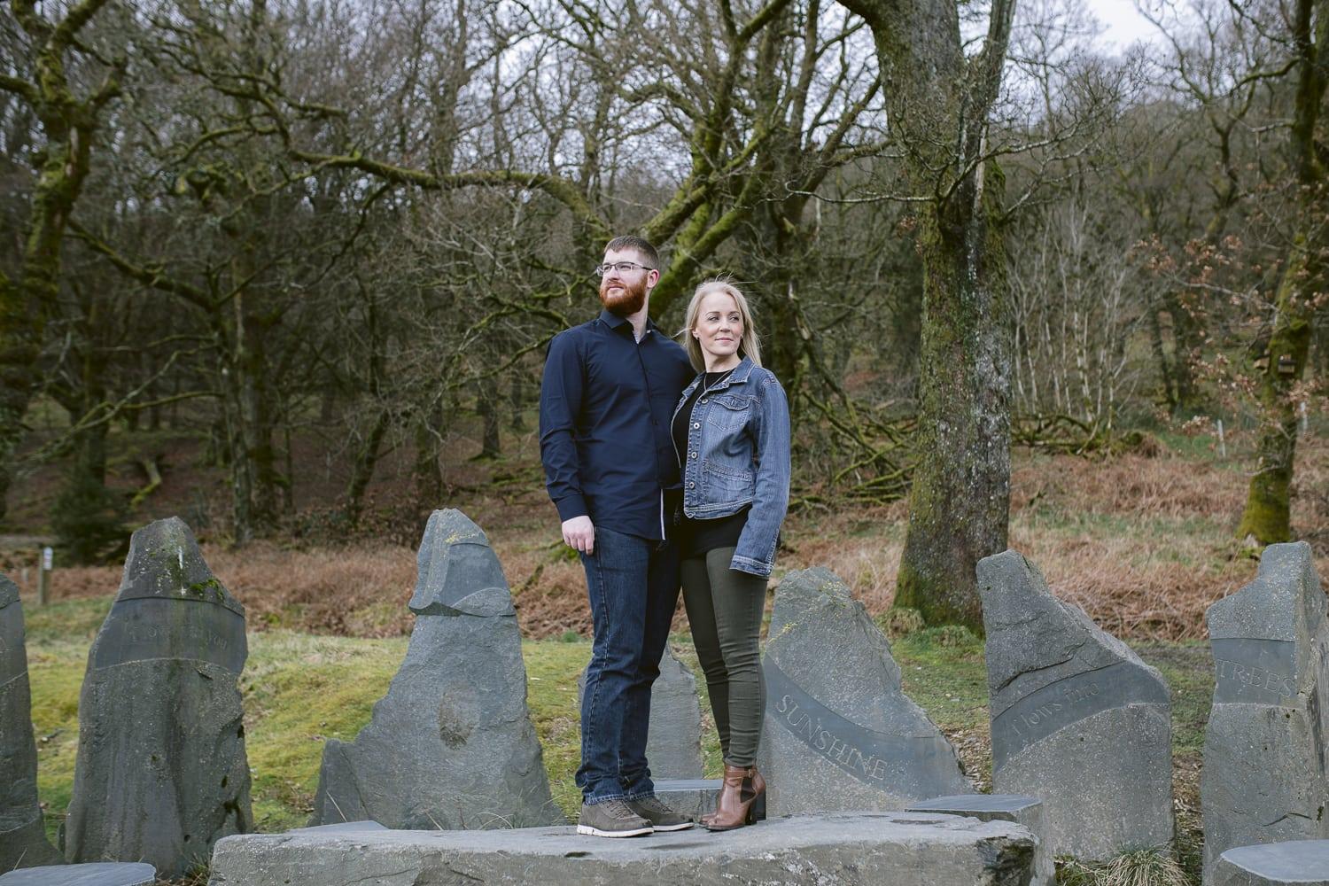 Couple stood on a stone table in the lake district