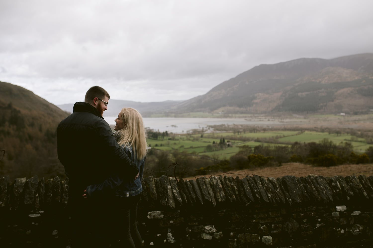 couple stood over the spot where he proposed to his now wife in the lake district.