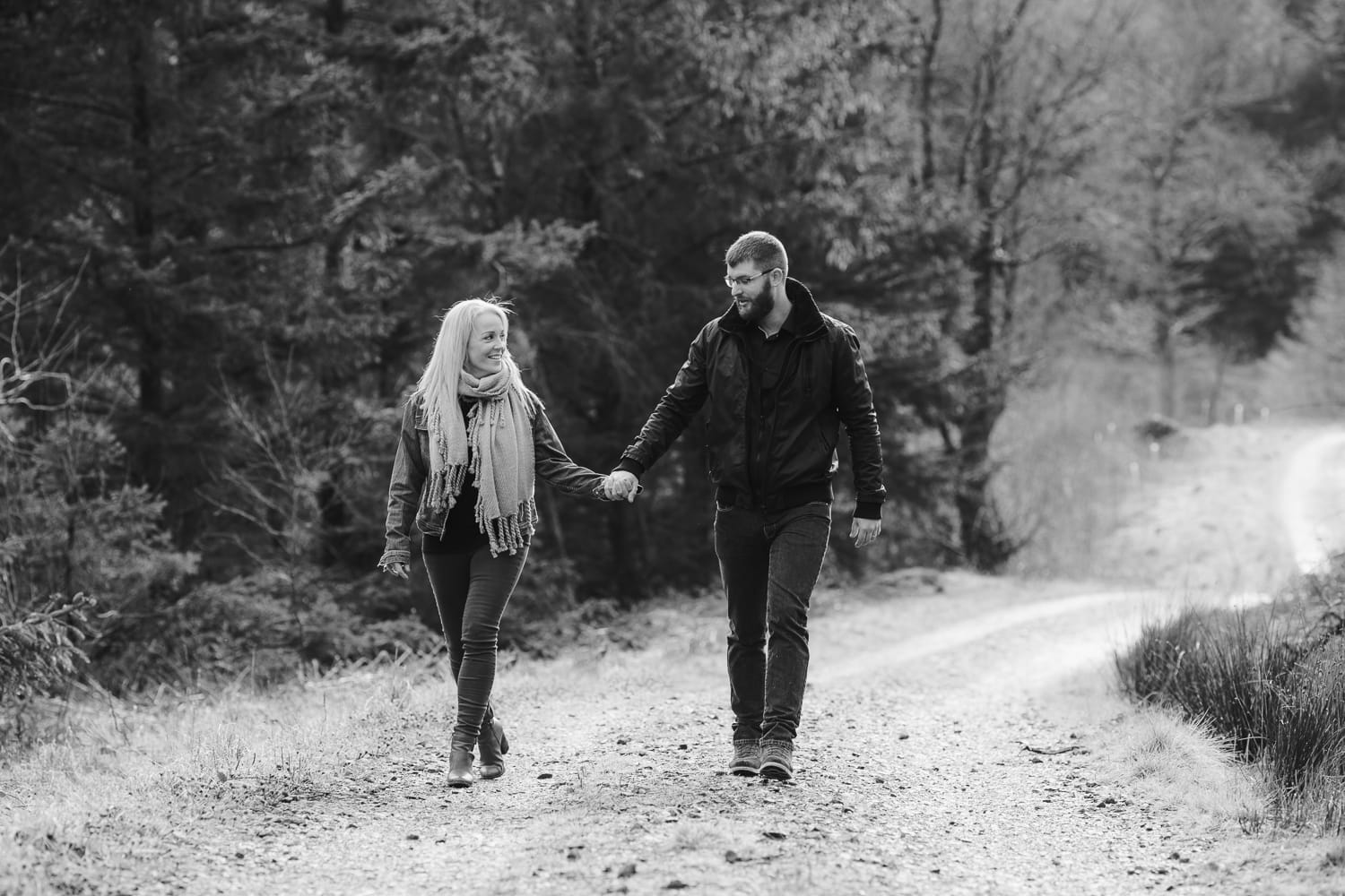 Couple wlaking along a path at whinlatter forest
