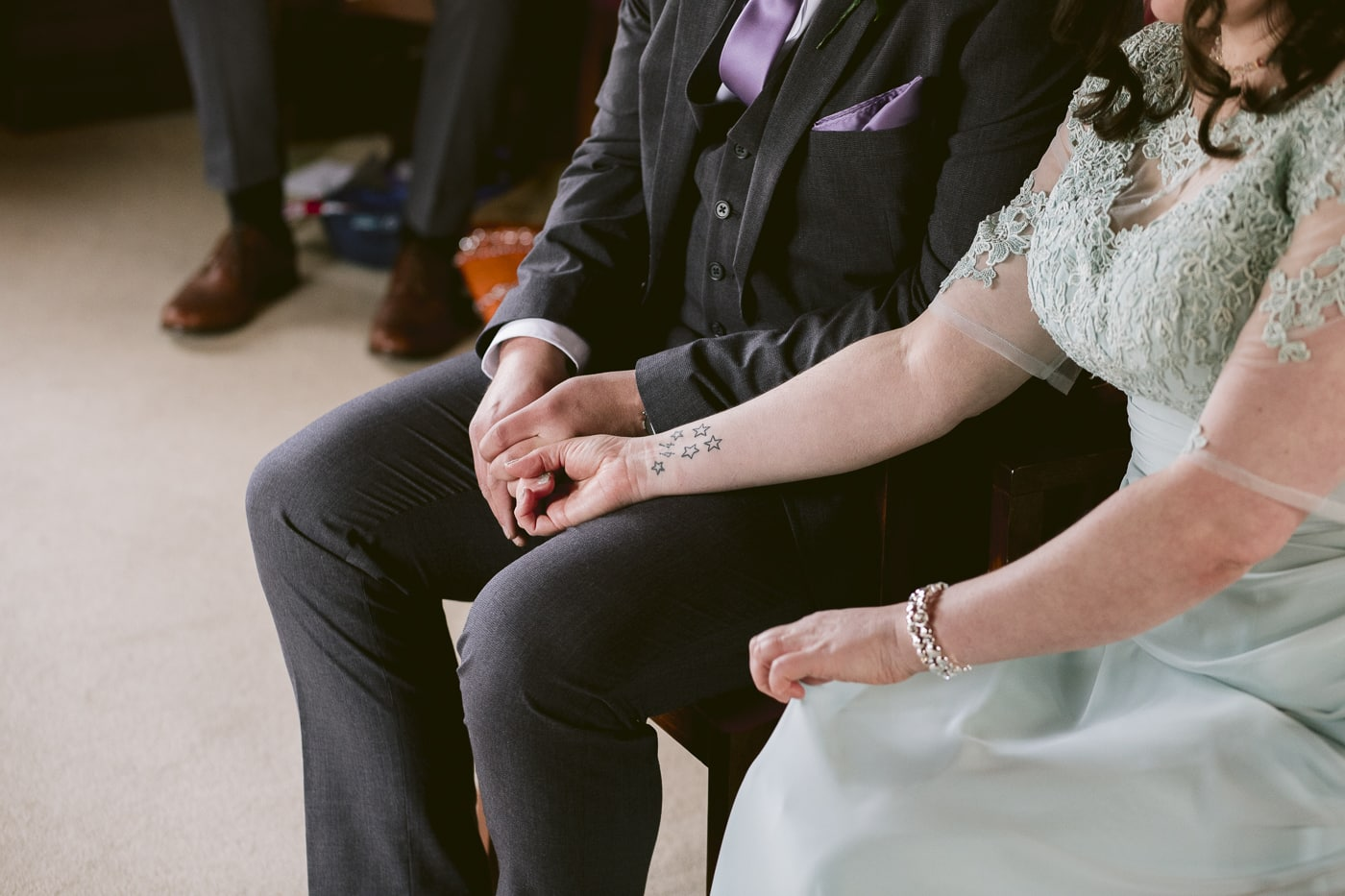 bride and groom holding hands in Carlisle Registry office