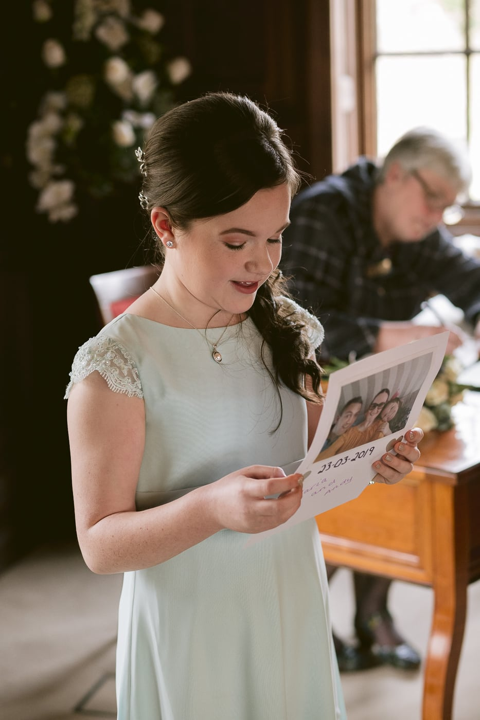bridesmaid reading for bride and groom