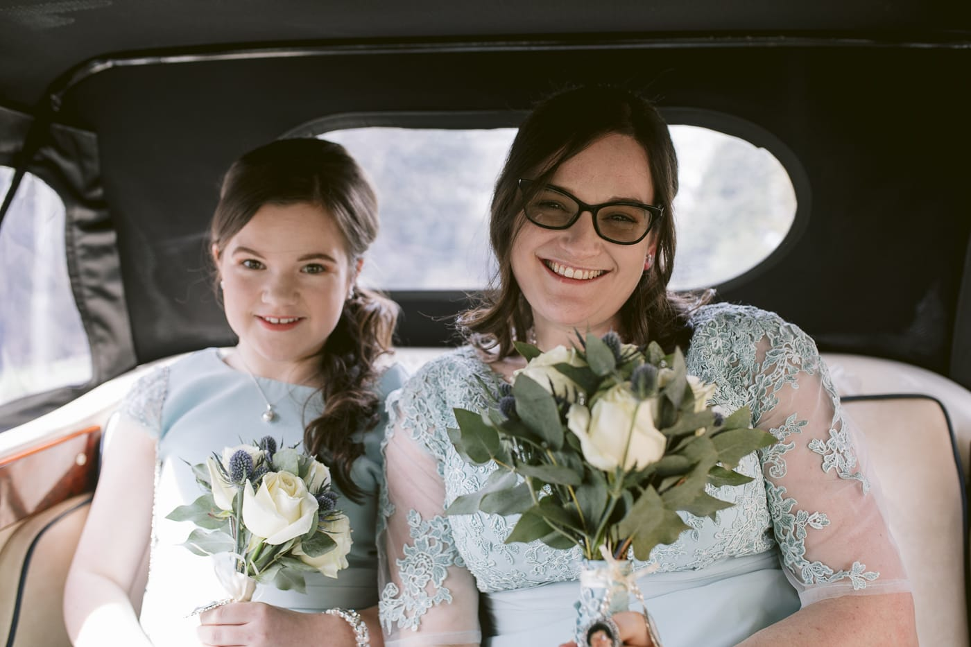 Bride and Bridesmaid in classic car