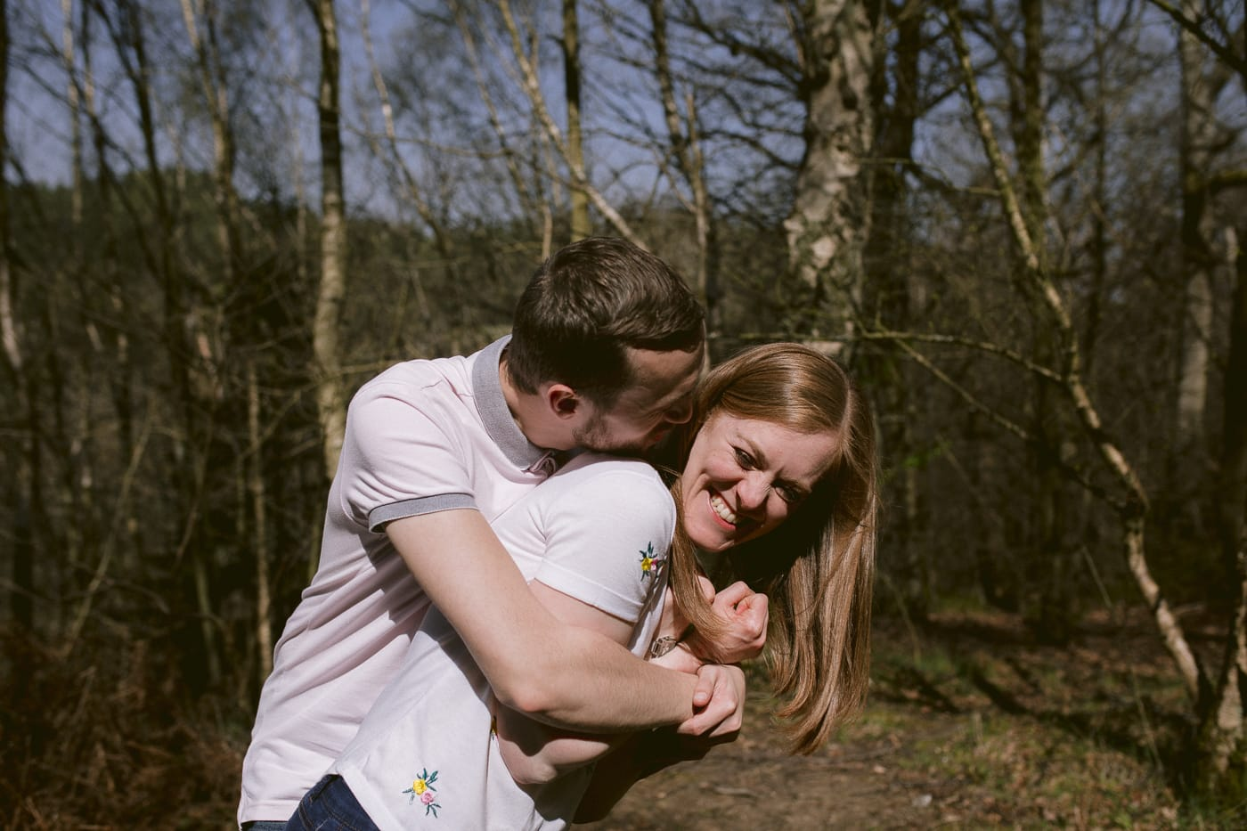 Ashley and Gerard Embraced in Arms in the Forest Portrait Session