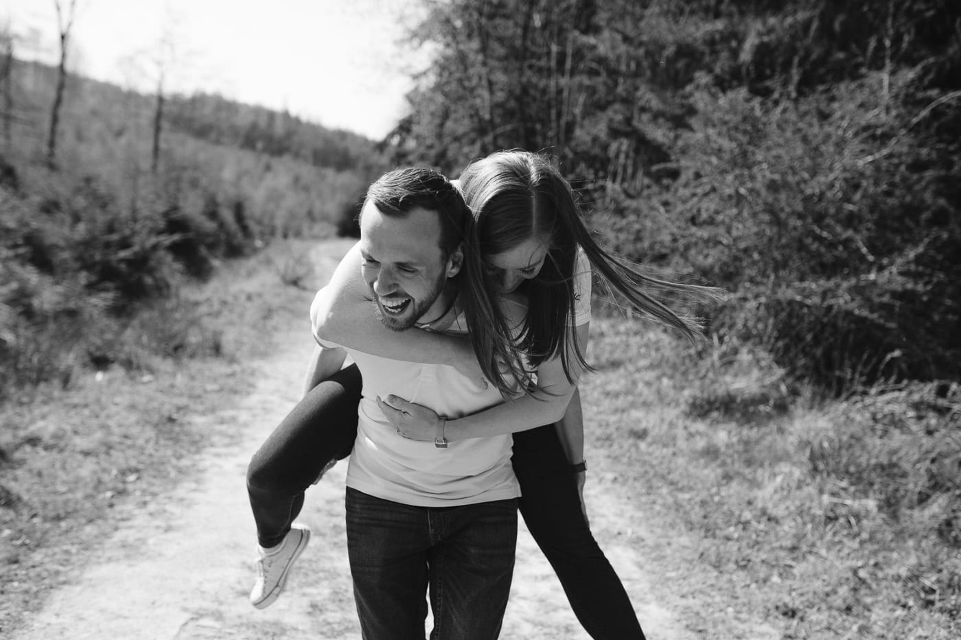 Ashley and Gerard Black and White Piggy Back Photography Portrait