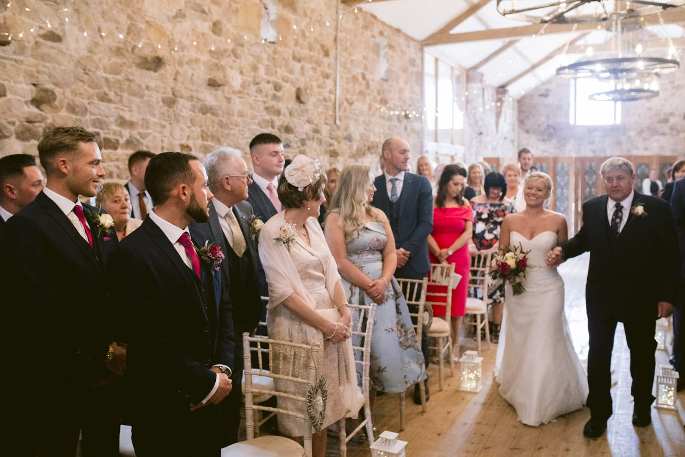 Guests Welcoming Bride Coming Down The Aisle with Bunch of Pretty Flowers Portrait Session