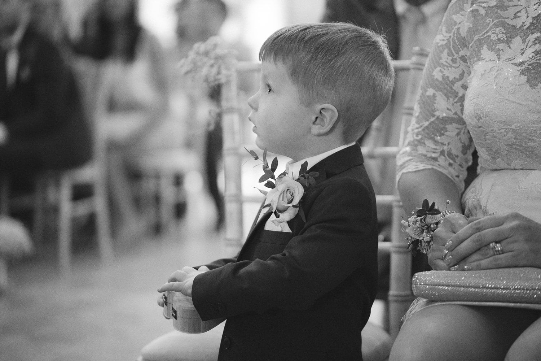 Little Boy Dressed Up In Suit Portrait Shoot Session