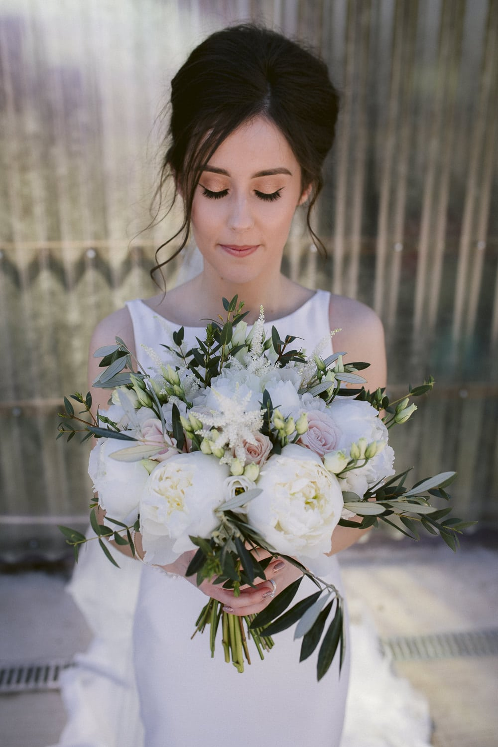 Bride with Bunch of Flowers Portrait