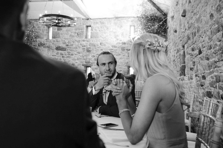 Wedding Guests Sat At Reception Tables