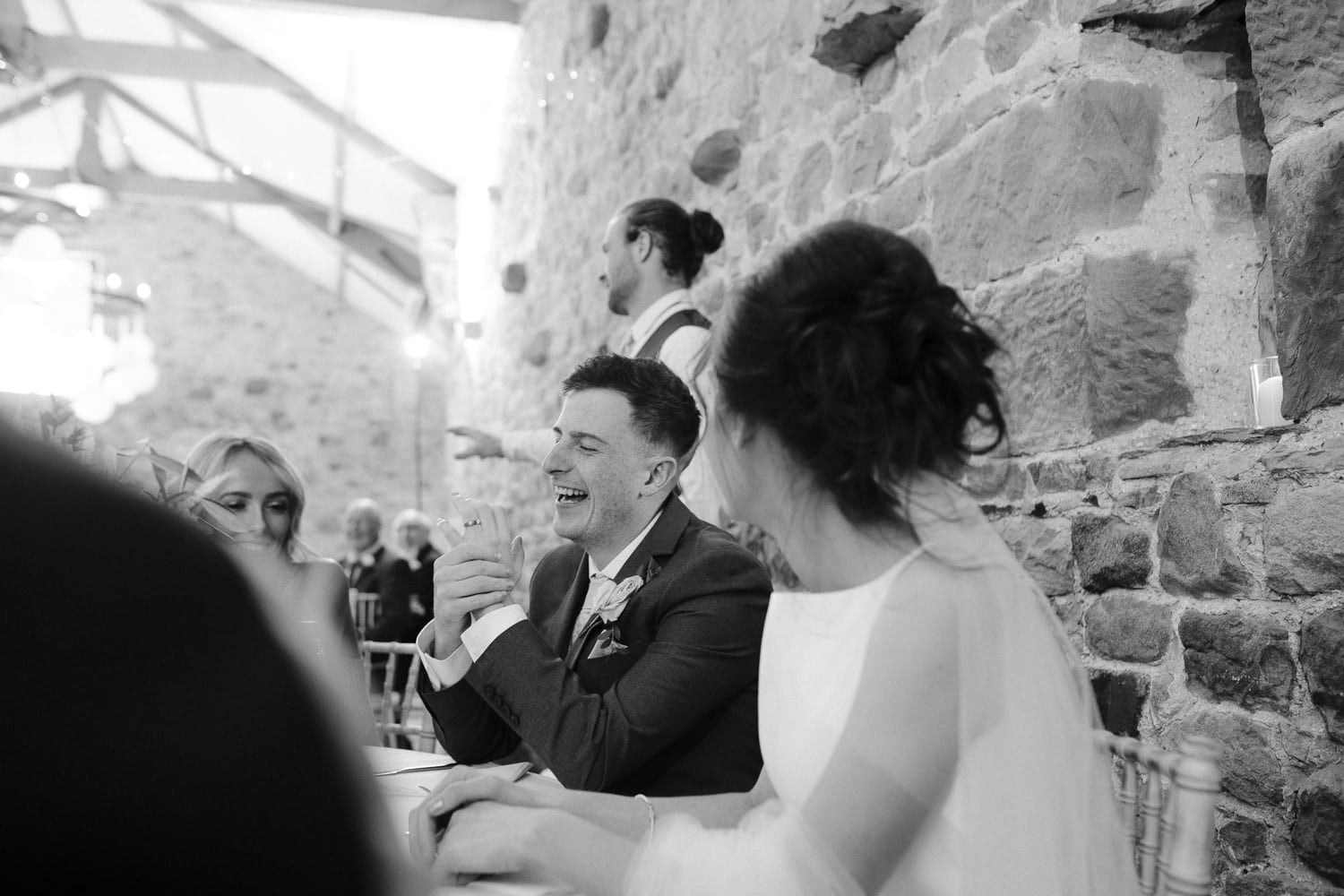 Beth and Ryan Sitting At Main Reception Table Portrait
