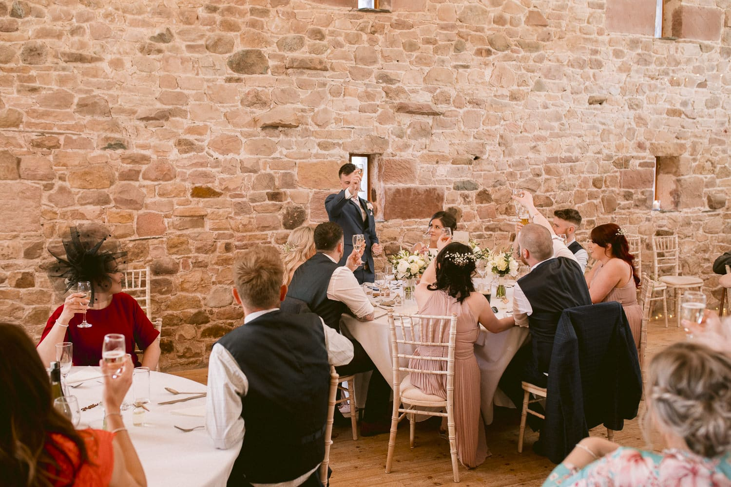 Groom Giving Speech at Reception Table