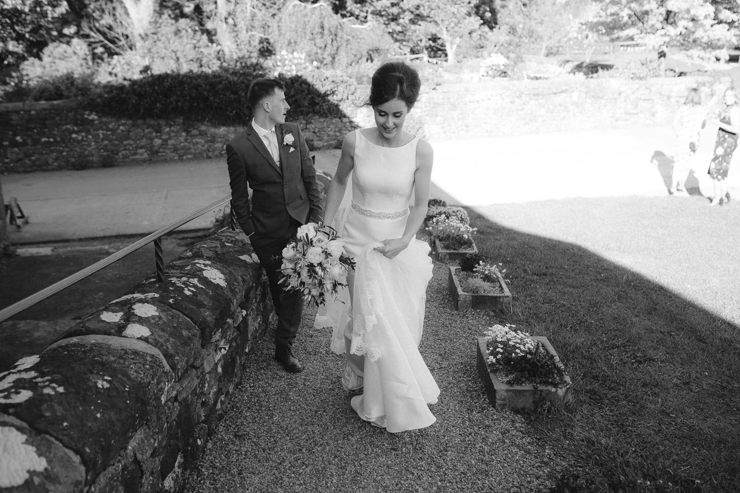 Bride and Groom Walking Down The Path Portrait Photography