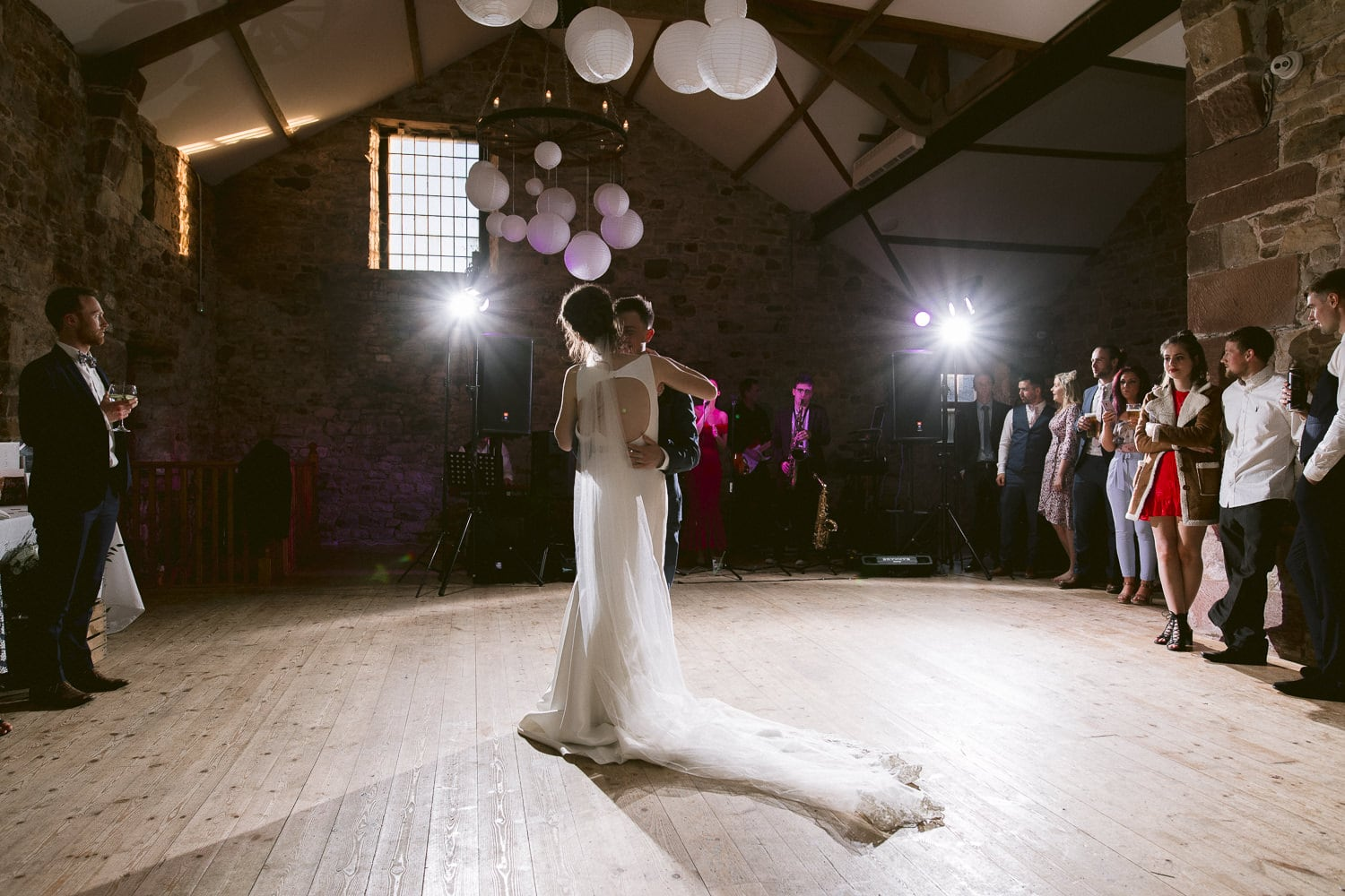 Bride In The Middle of Dance Floor With Guests Photography Shoot