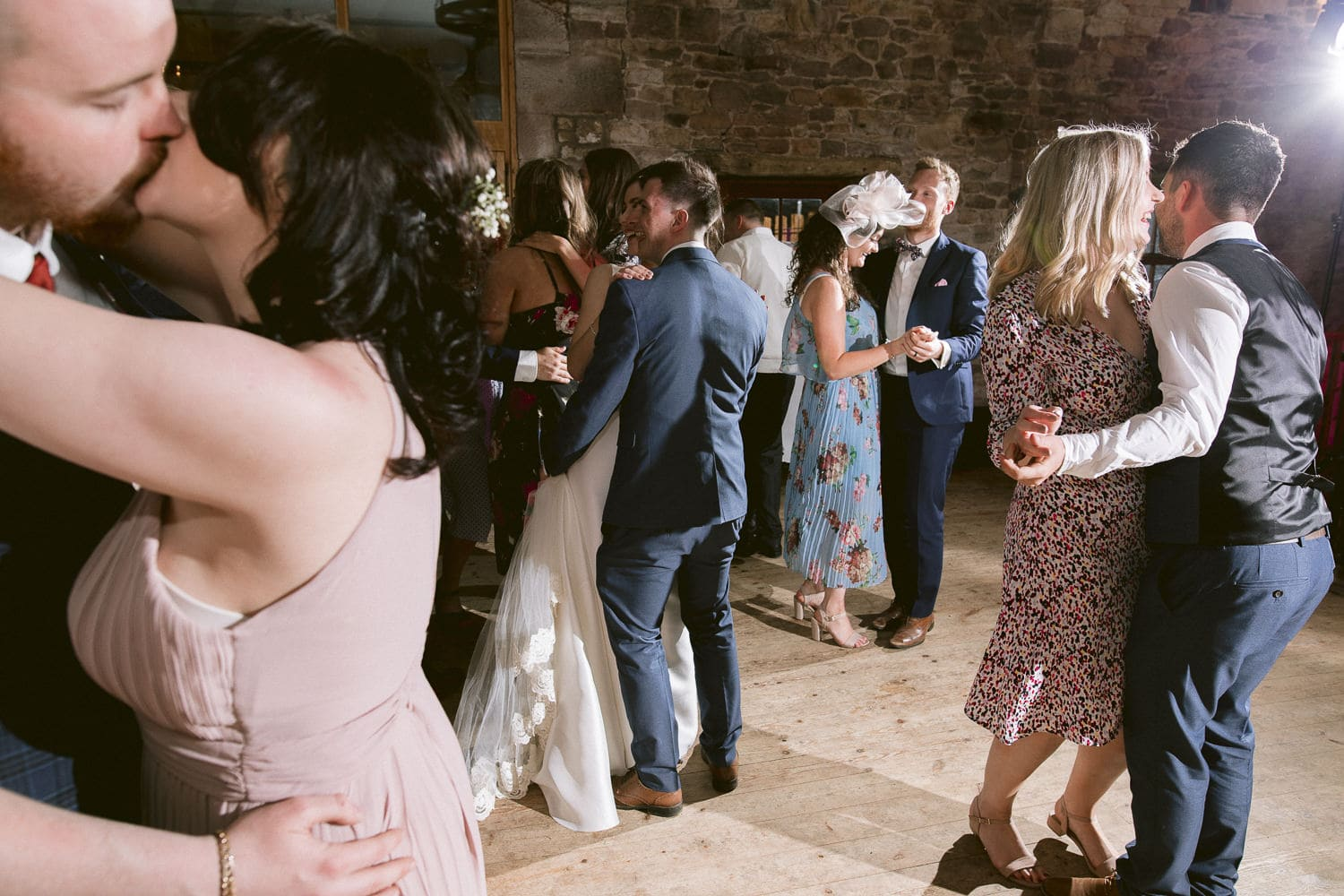 Beth and Ryan on the Dance Floor with Guests at Three Hills Wedding