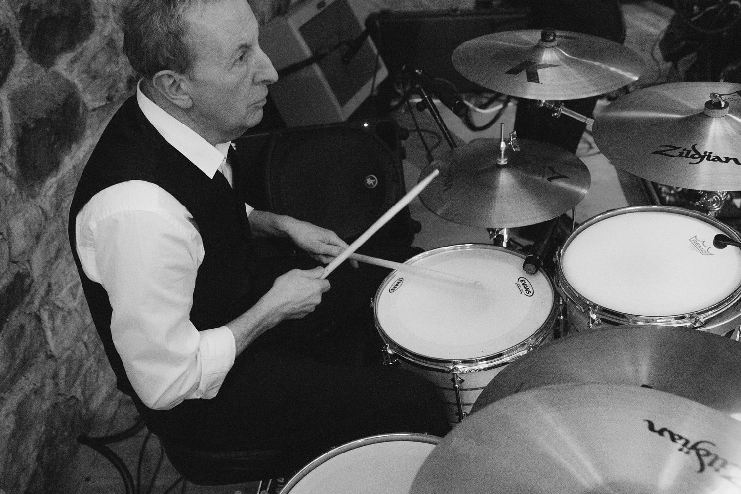 Man Playing Drums With Band