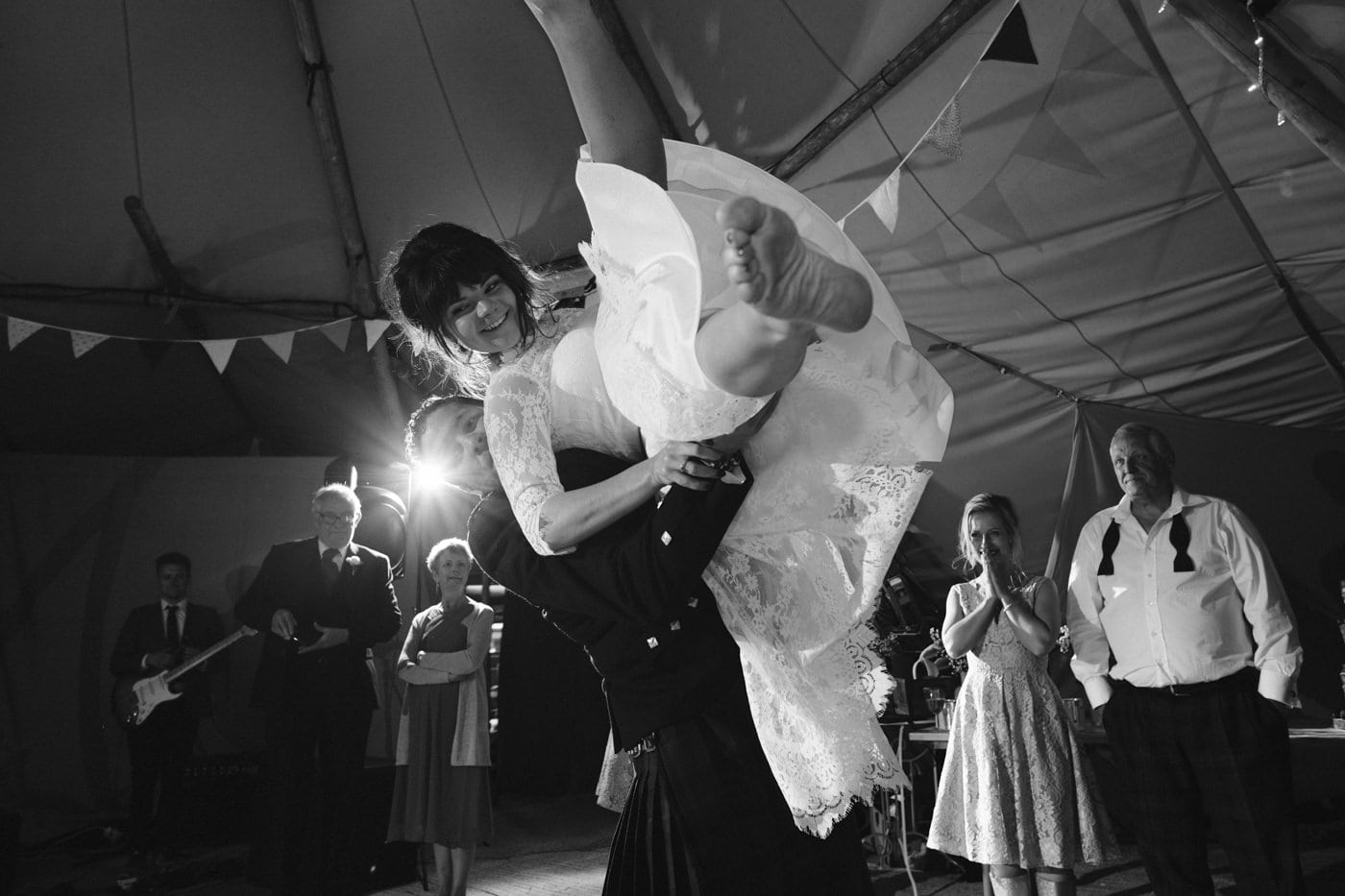 Bride and groom first dance in tipi wedding in the lake district