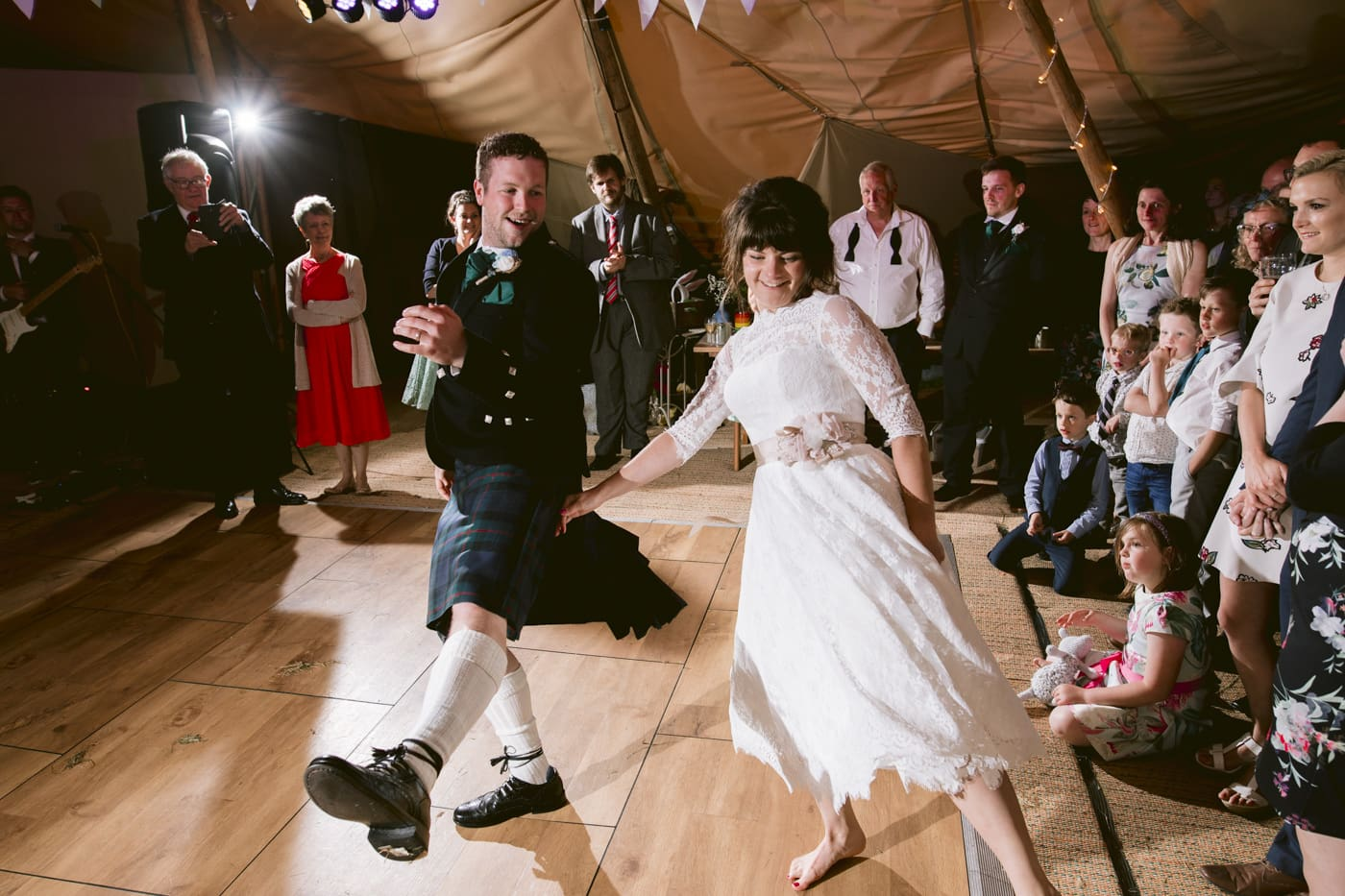 Bride and Groom Synchronised Dancing in Tipi Tent The Lake Destrict