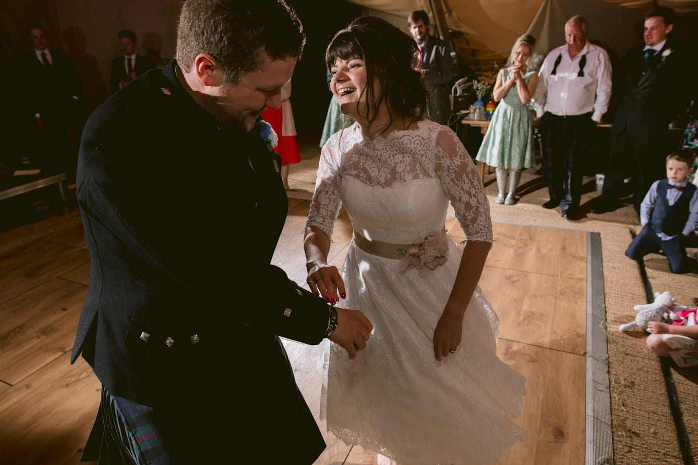 Bride and Groom Talking and Dancing at Tipi Wedding On The Shores Of Ullswater