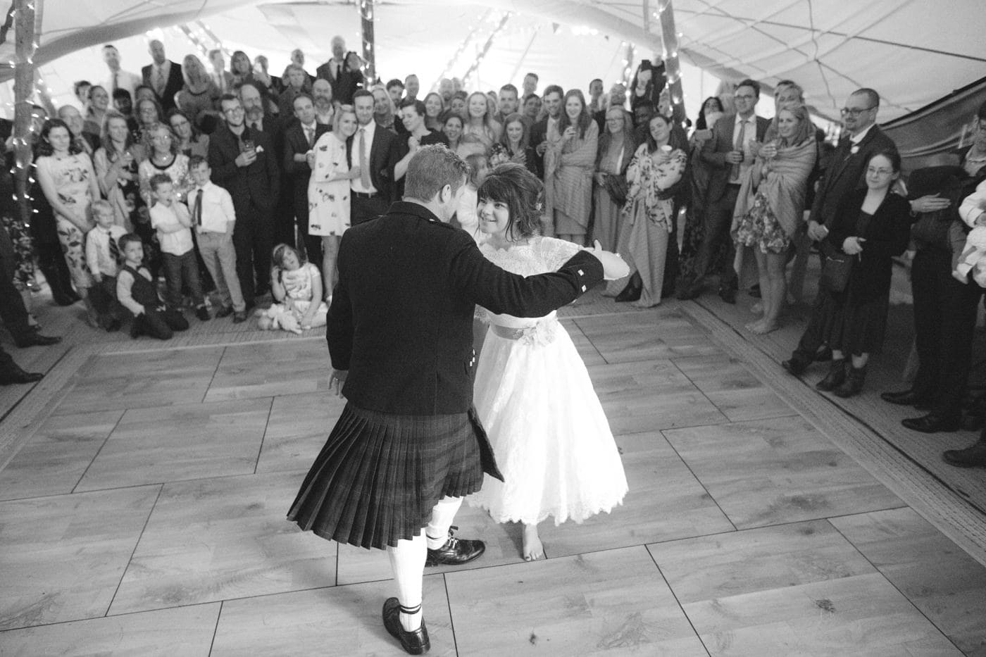 Bride and Groom Swing Dancing in Tipi
