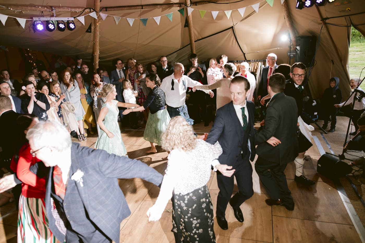 Guests Lined up Dancing in Main Tipi Venue Hall
