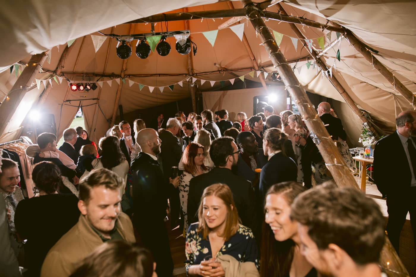 Group Shot in Tipi of Guests Dancing