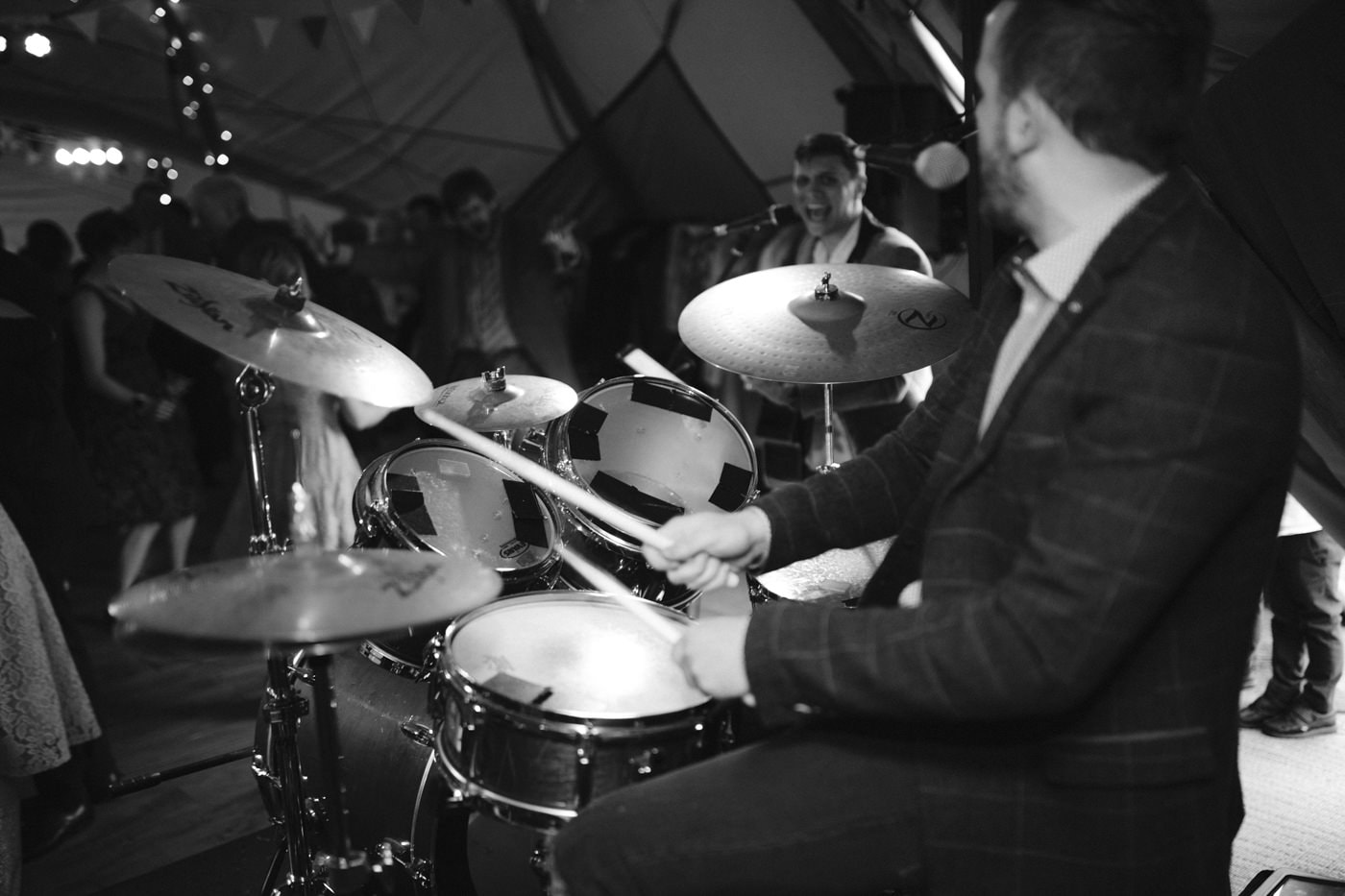 Portrait of Drummer at Wedding Venue Under Tipi Tent