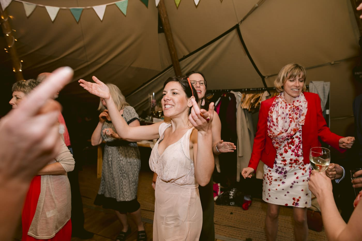 Woman in Pink Dress Dancing with Guests