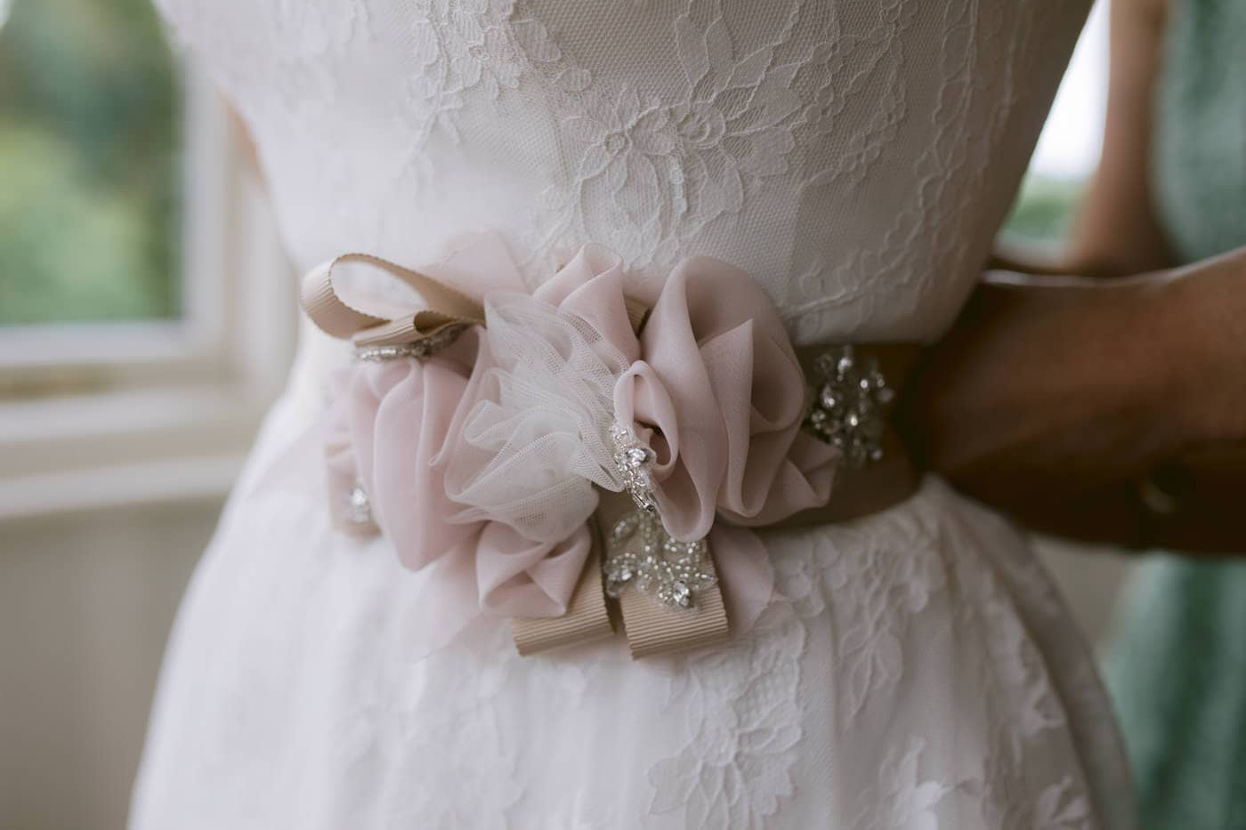 Belt Buckle and Tied Bun on Wedding Dress