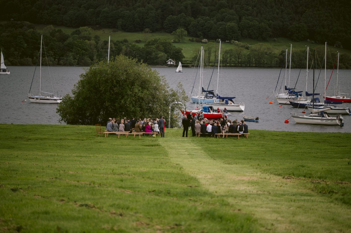 Guests at Wedding Venue by the Lakeside, Ready for Bride and Groom