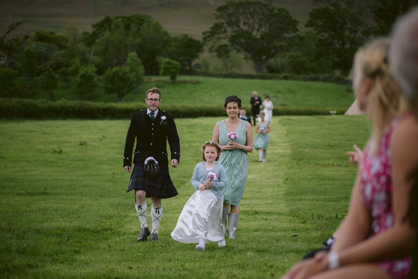 Walking down the Aisle at Tipi Wedding On The Shores Of Ullswater
