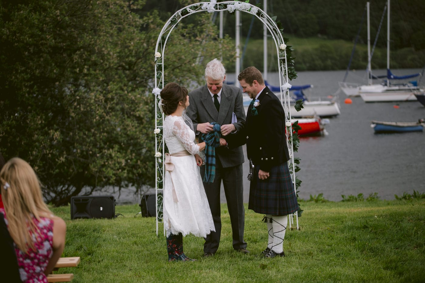 Bride and Groom Passing the Rings at Tipi Wedding On The Shores Of Ullswater