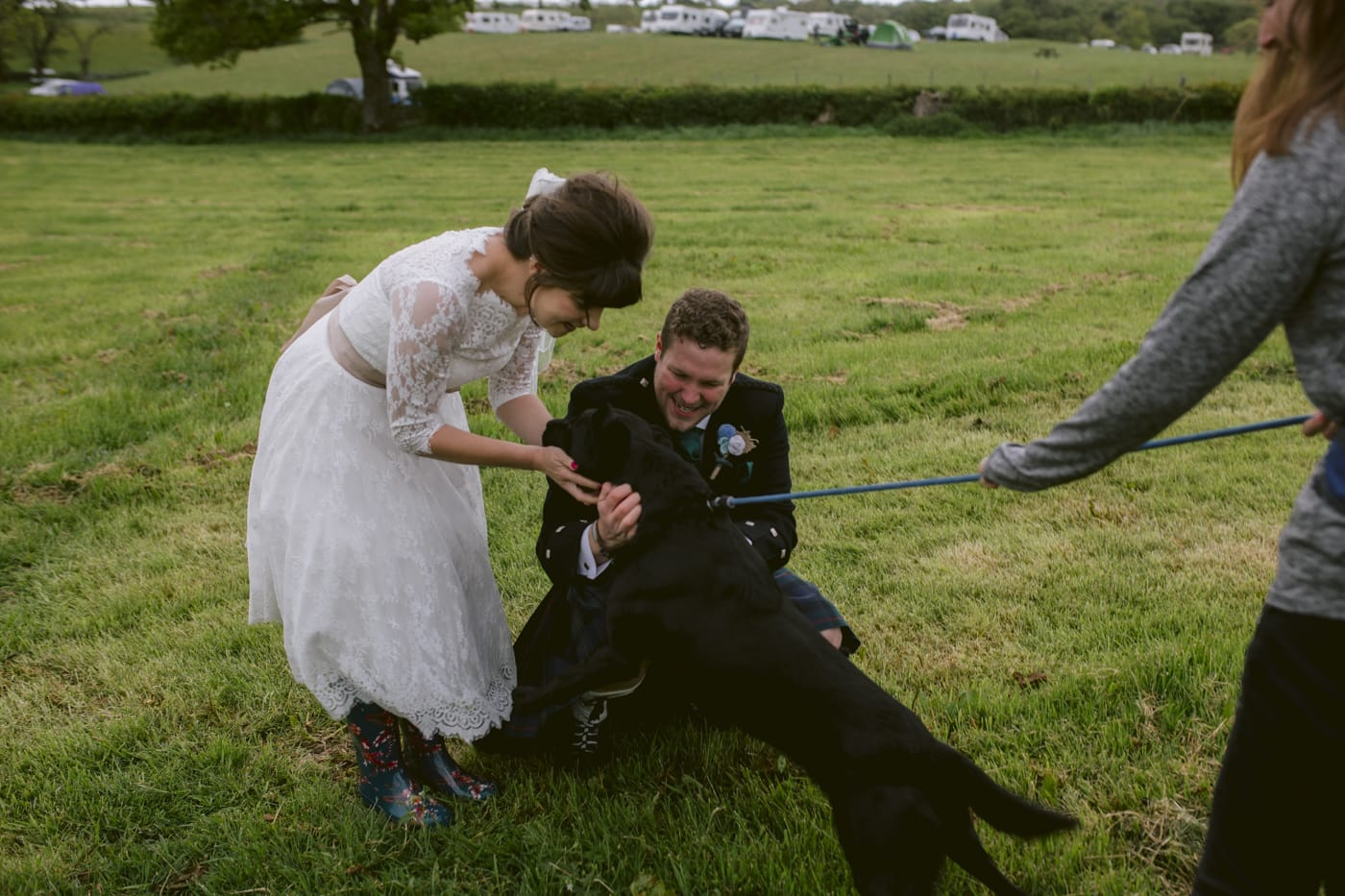 Bride Stroking Dog outside of Wedding Venue, Married, Happy