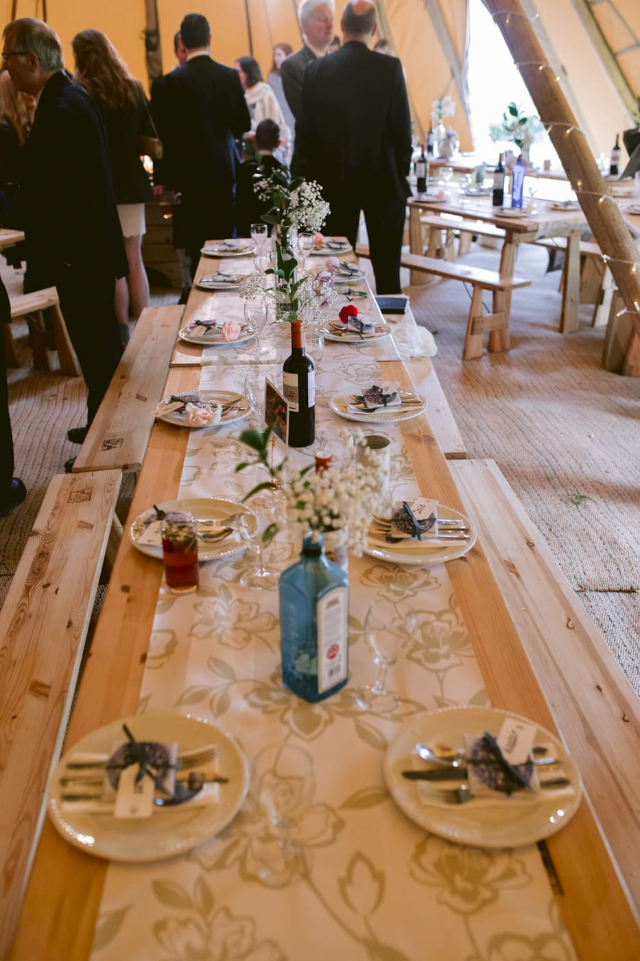 Table Decorated with Bottles and Place mats
