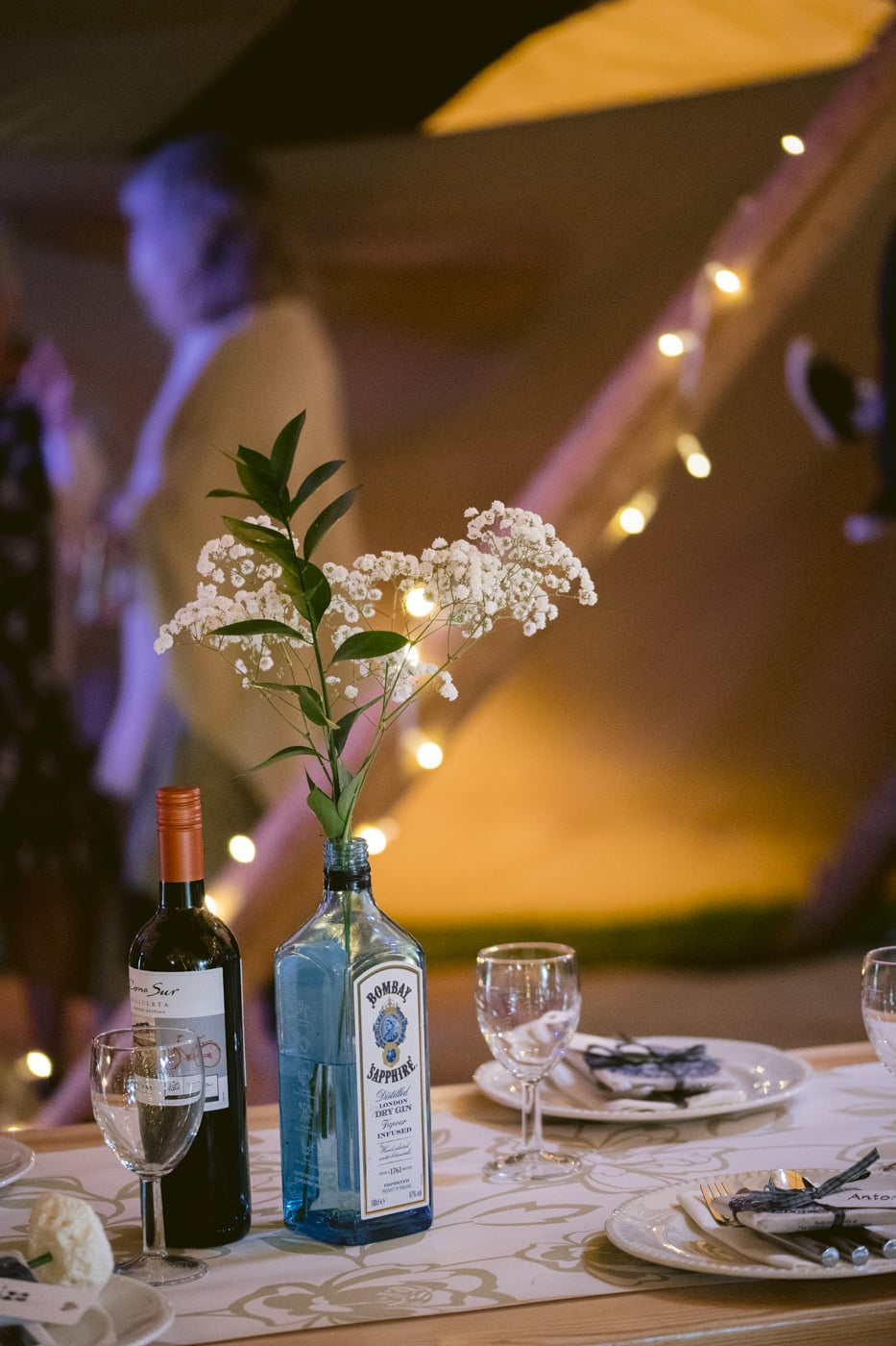 Table Decorated with Flower in Bottle
